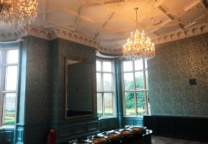 Hotel redecorated with high-end wallpaper and painted ceilings