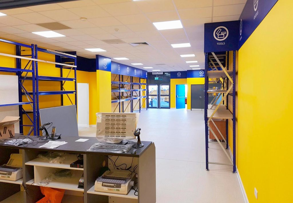 A commercial unit painted with vibrant yellow walls
